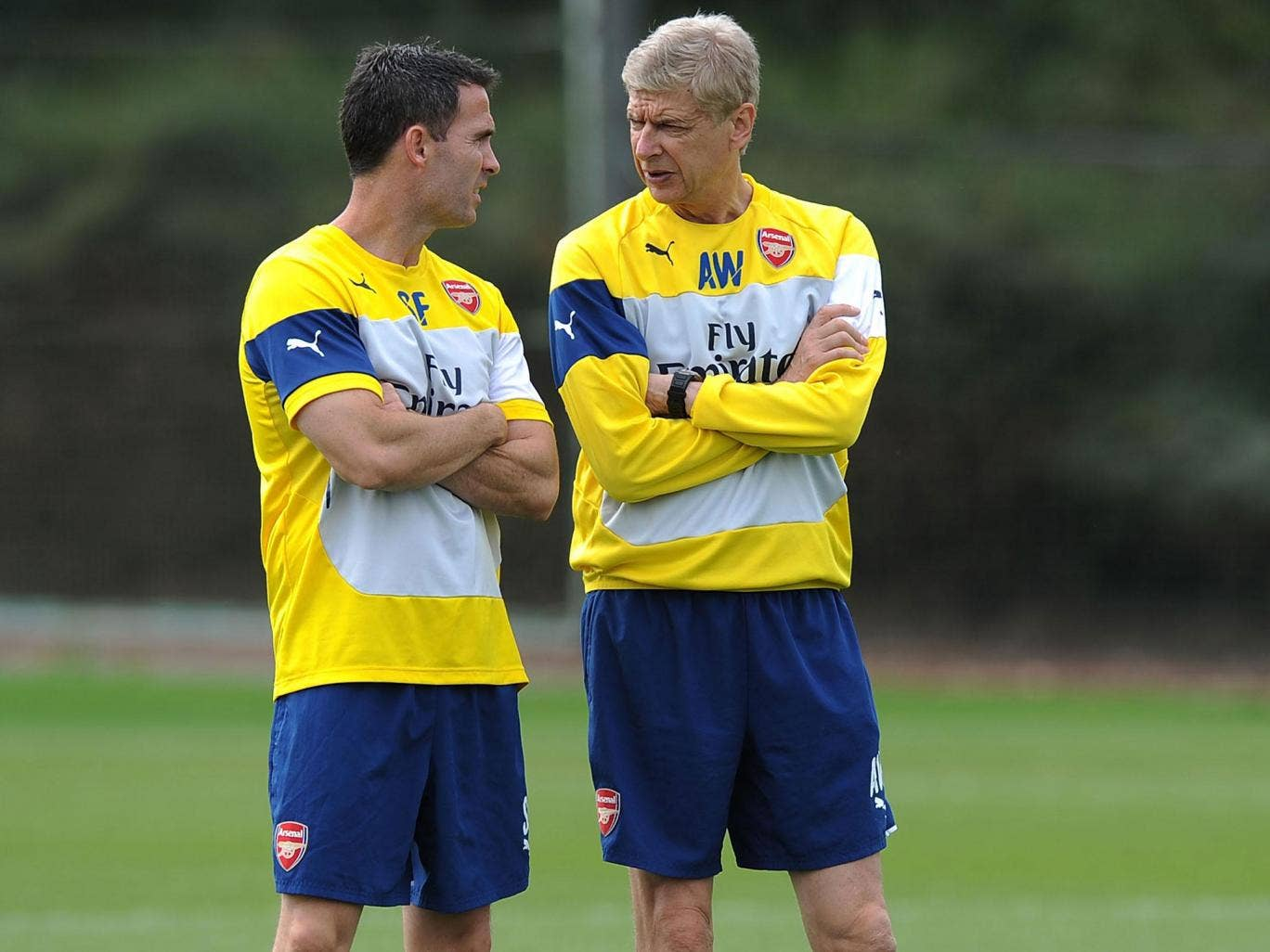 Shad Forsythe (right) converses with Arsenal manager Arsene Wenger during the Gunners' pre-season training
