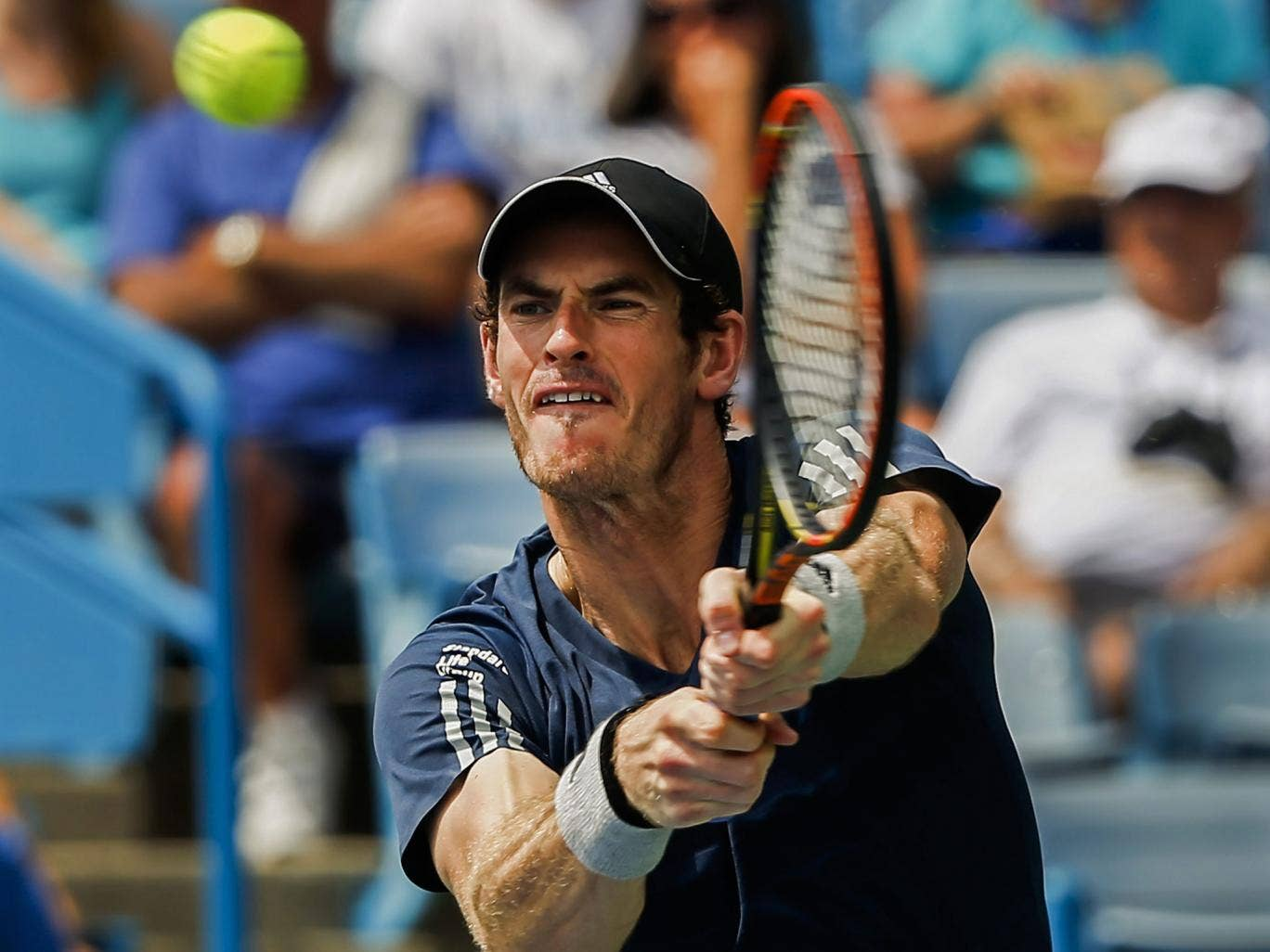 Andy Murray had to save two match points to beat John Isner