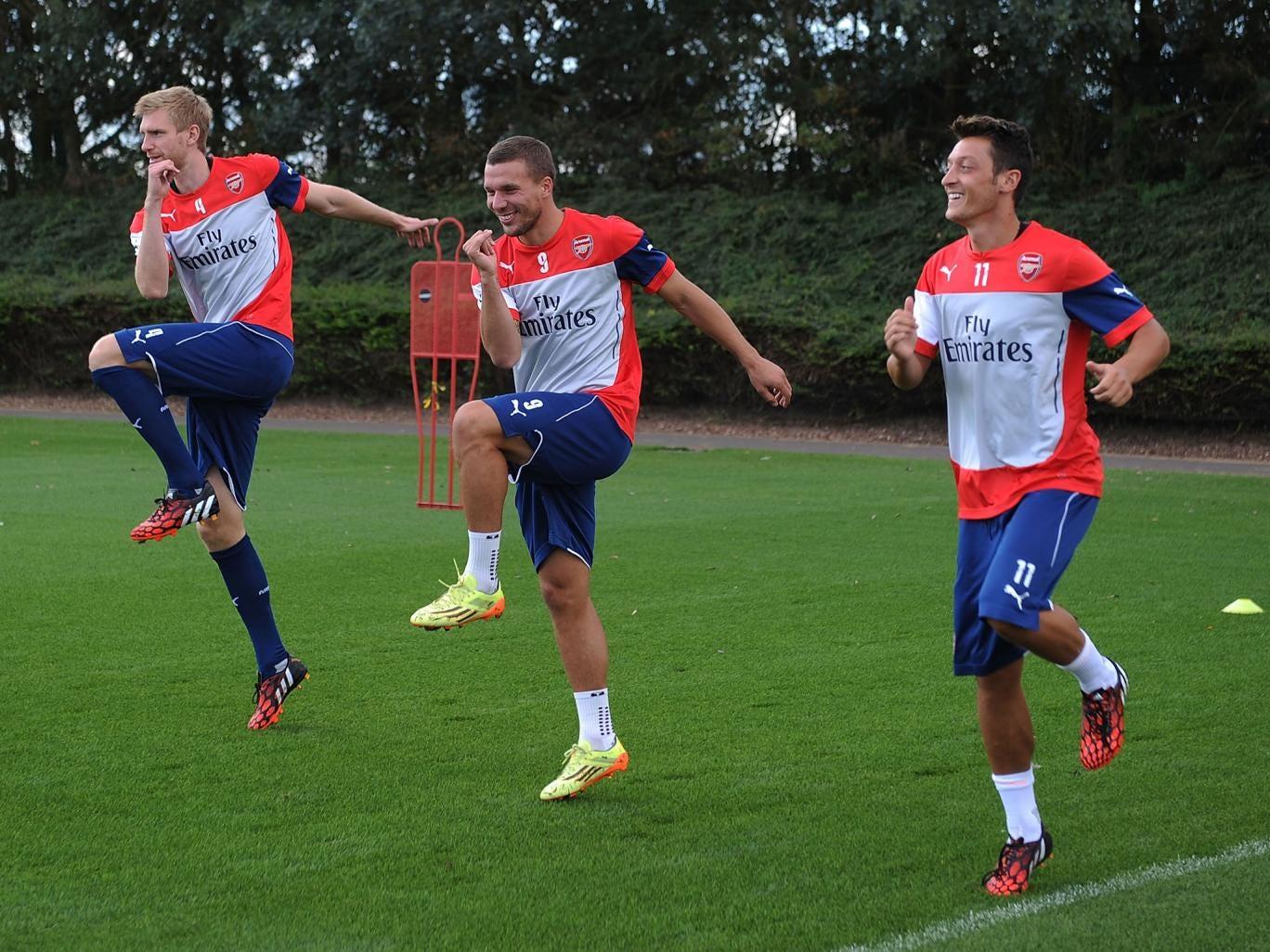 Per Mertesacker, Lukas Podolski and Mesut Ozil during Arsenal training