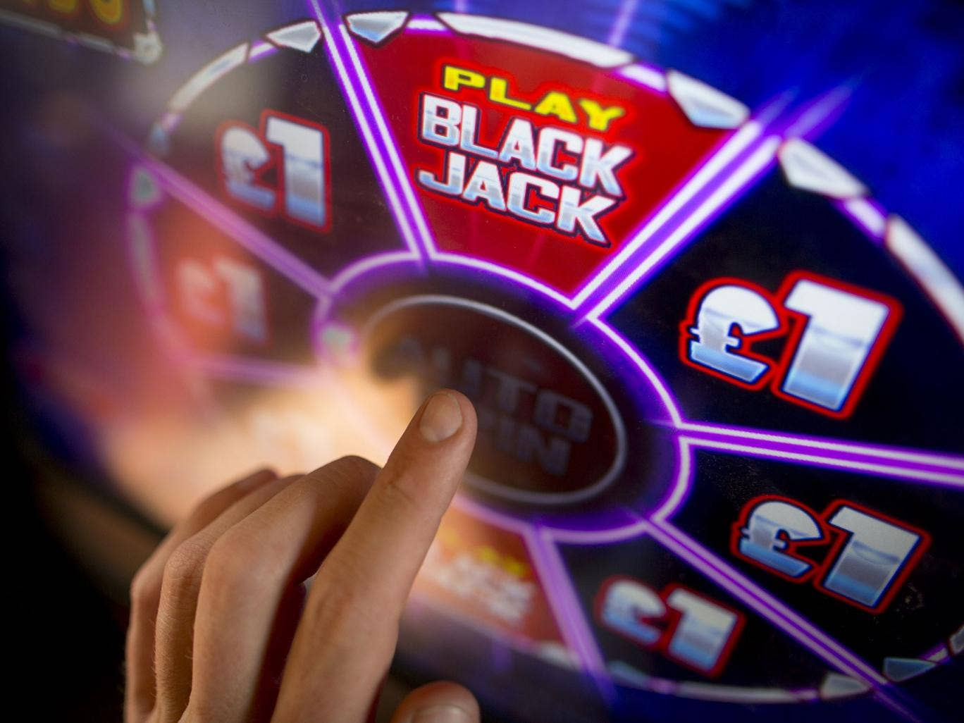 A blackjack game in a pub in Hounslow. Digital gaming machines in pubs offer far inferior odds to those in a casino