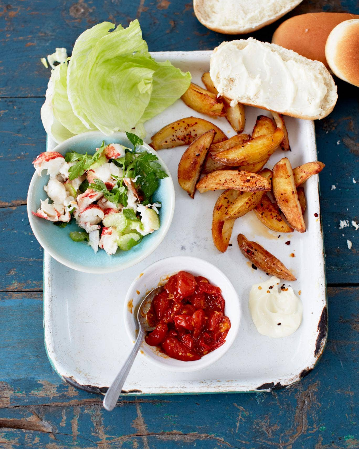 Serve up everything on individual plates so guests can put together their own lobster rolls, with a chilli relish and chips on the side