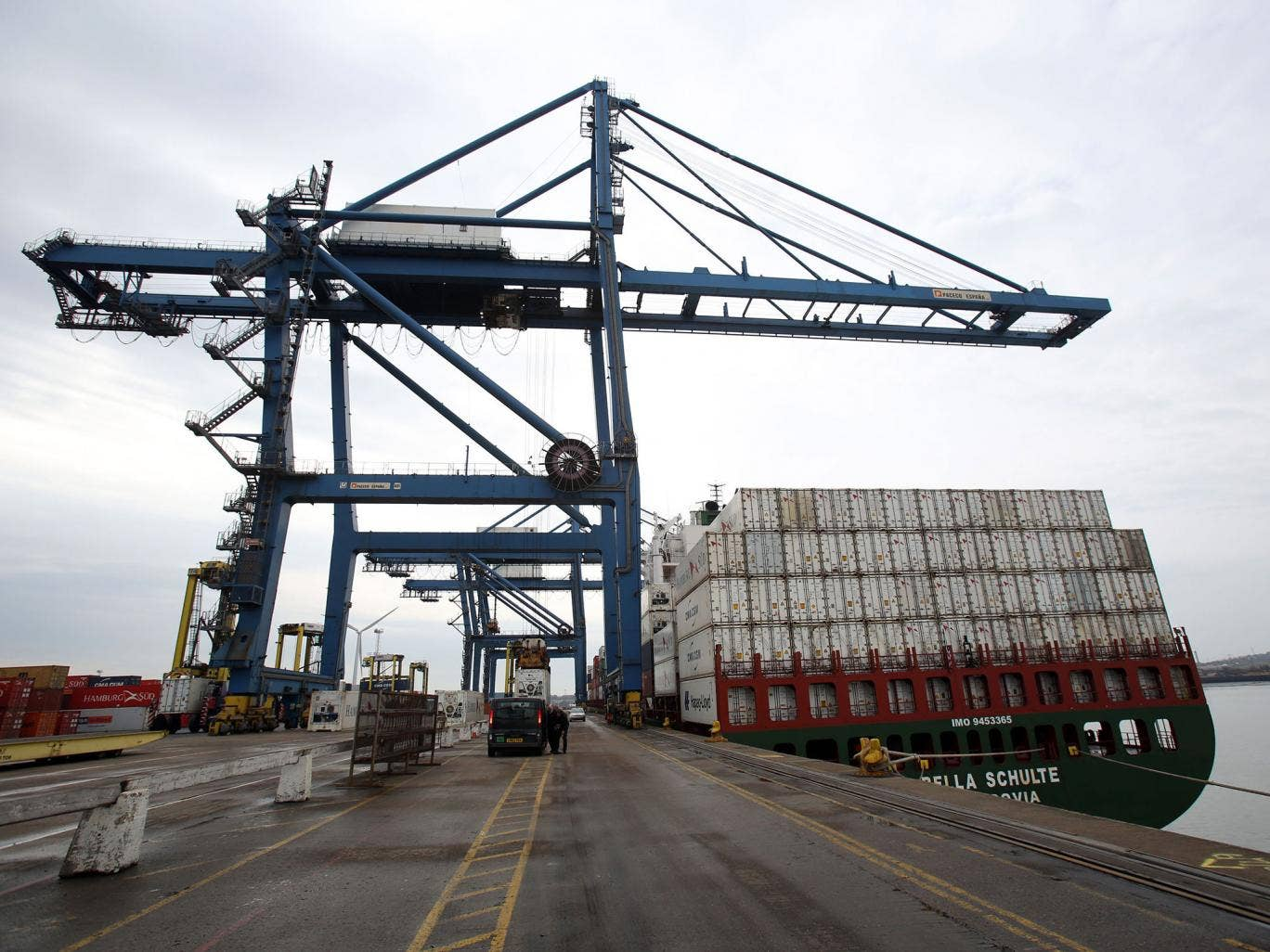 """File photo dated 31/3/2014 of a crane along the quay side at Tilbury Docks in Essex. A man has died and other people have been taken to local hospitals with """"significant health problems"""" after 31 adults and children were found inside a shipping container"""