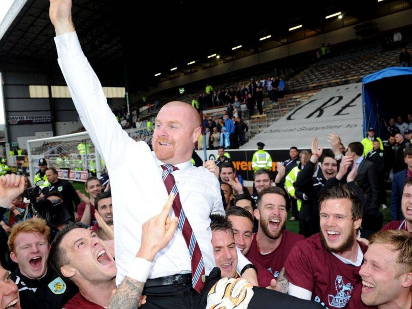 Burnley's manager Sean Dyche celebrates after his side win promotion to the English Premier League during their championship match at Turf Moor, Burnley England