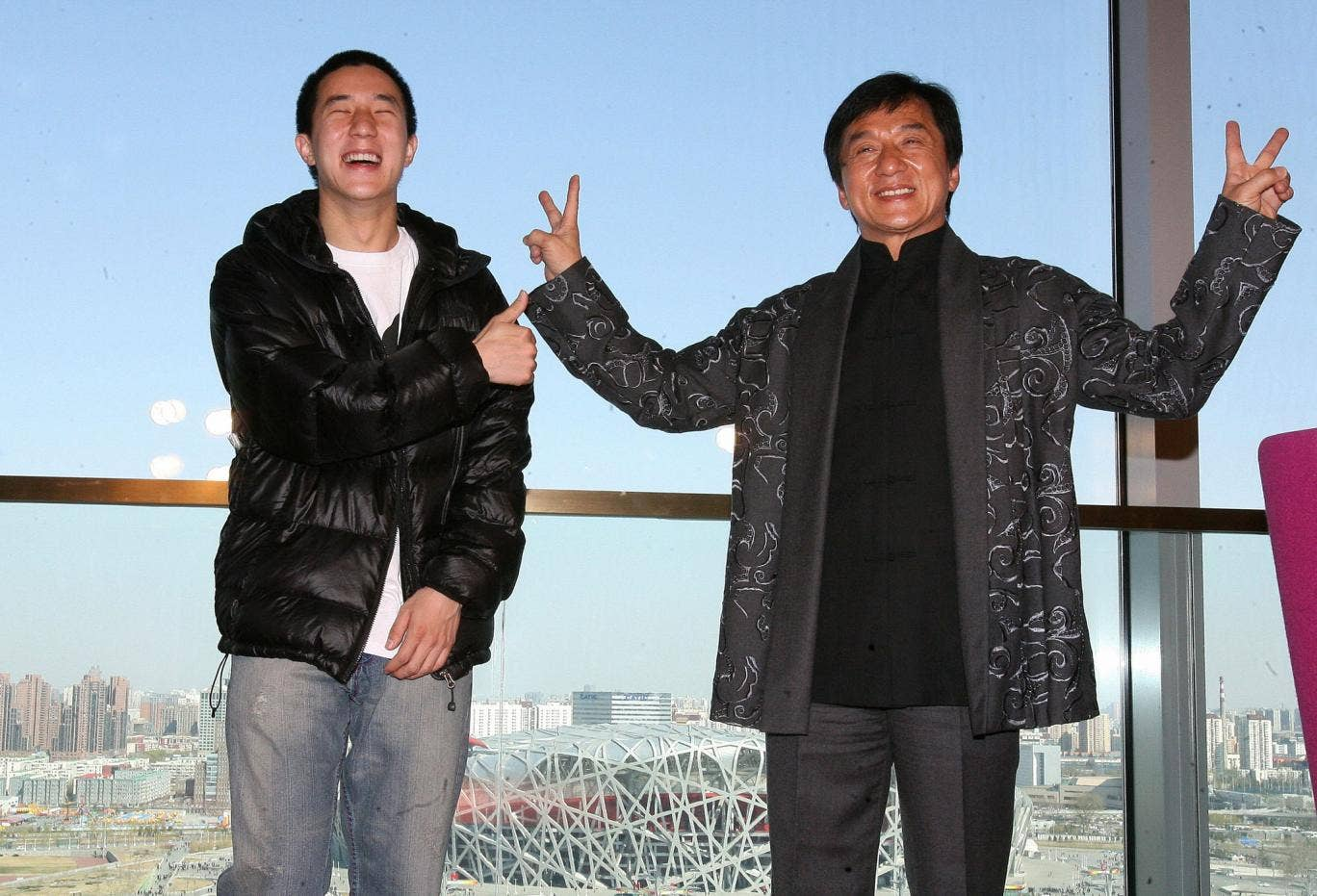 Jaycee and Jackie Chan take part in a press conference for Chan's concert at Beijing's Bird's Nest stadium in 2009