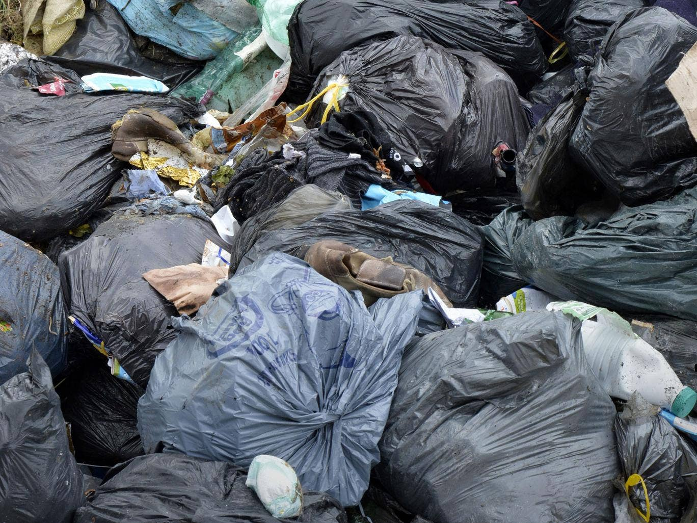 Garbage bags pile up at the Technical Landfill Centre (ETC) of Villemarche that handles the disposal of organic waste dumped at site in Tence on April 22, 2014.
