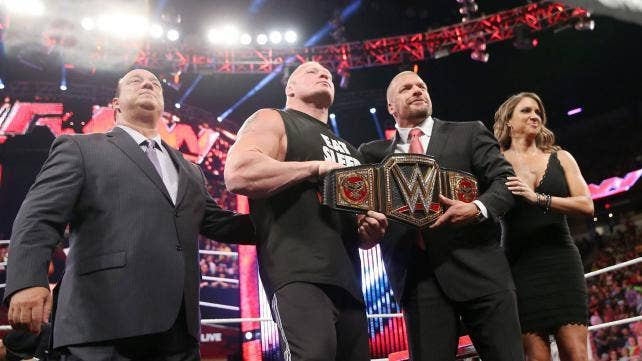 Heyman, Lesnar, Triple H and Stephanie put their best smiles on