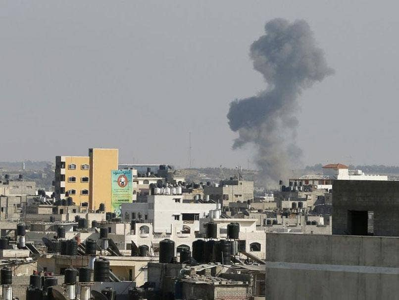 Smoke is seen after what witnesses said was an Israeli air strike in Gaza City August 19, 2014.