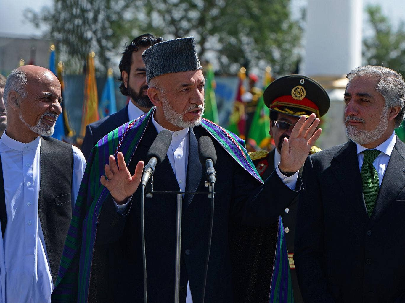 Hamid Karzai (centre) has agreed to step down as Ashraf Ghani (left) and Abdullah Abdullah (right) fight to succeed him