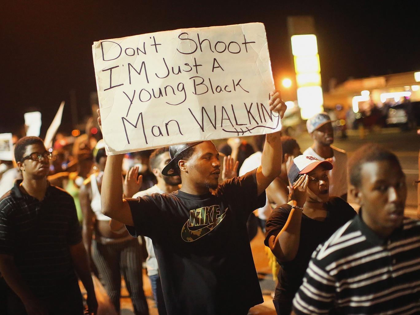 Demonstrators protest the killing of teenager Michael Brown on August 19, 2014 in Ferguson, Missouri.
