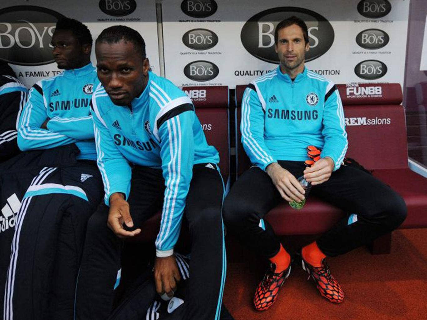 Petr Cech (right) and Chelsea's Didier Drogba (left) sit on the bench before the match between Burnley and Chelsea on Monday