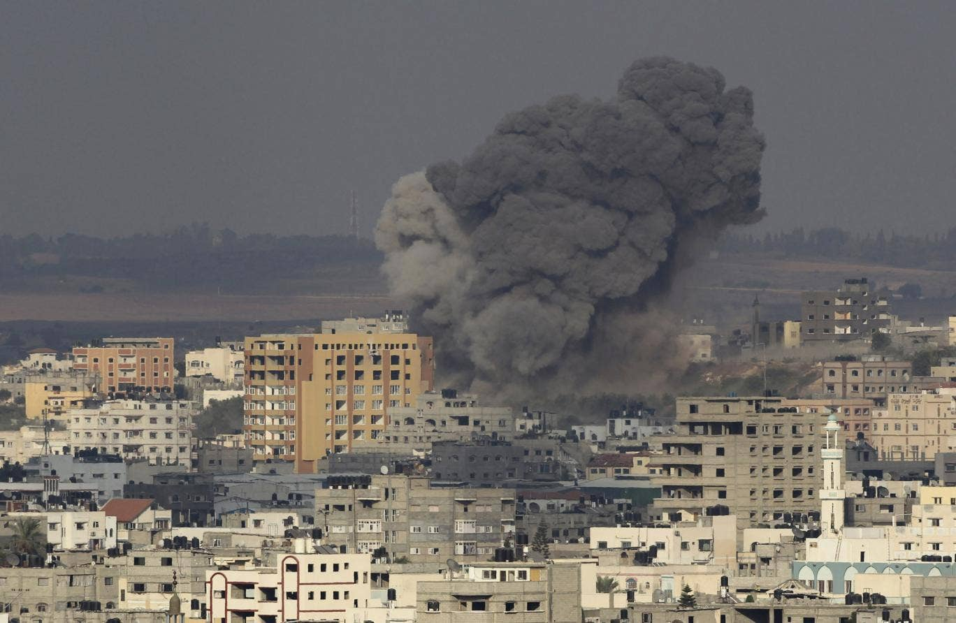 Smoke rises following what witnesses said was an Israeli air strike in Gaza on 22 August 22