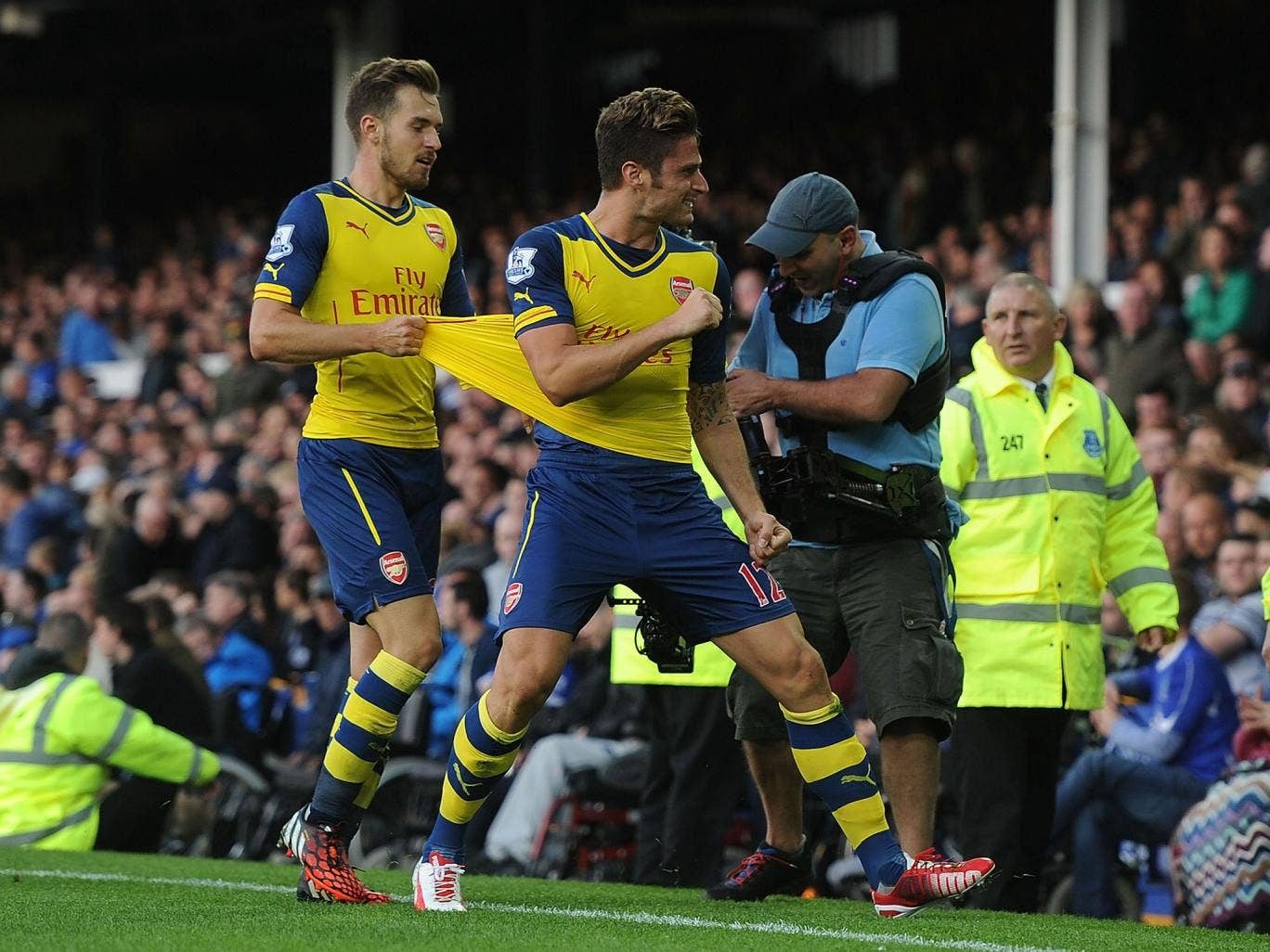 Olivier Giroud celebrates after his late goal saved Arsenal a point at Goodison Park