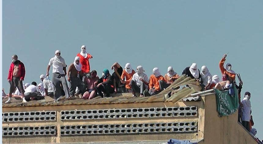 Inmates seen on the roof of a building during the riot