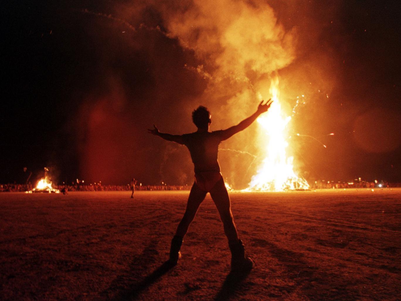 A festival-goer celebrates the end of Burning Man festival in Nevada