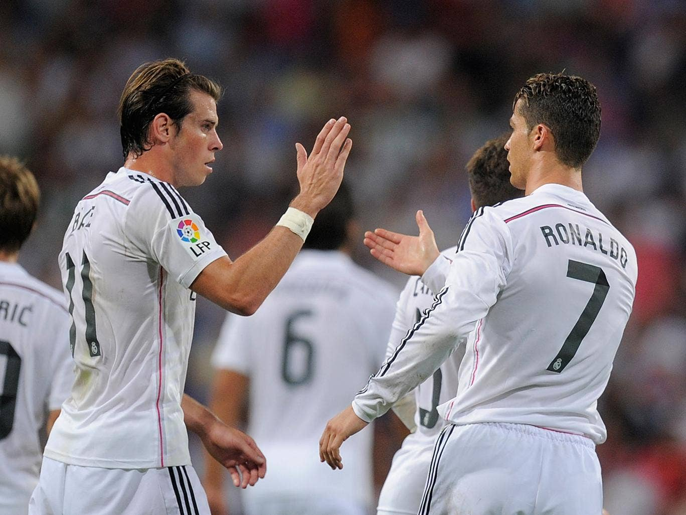 Cristiano Ronaldo of Real Madrid celebrates with Gareth Bale after scoring
