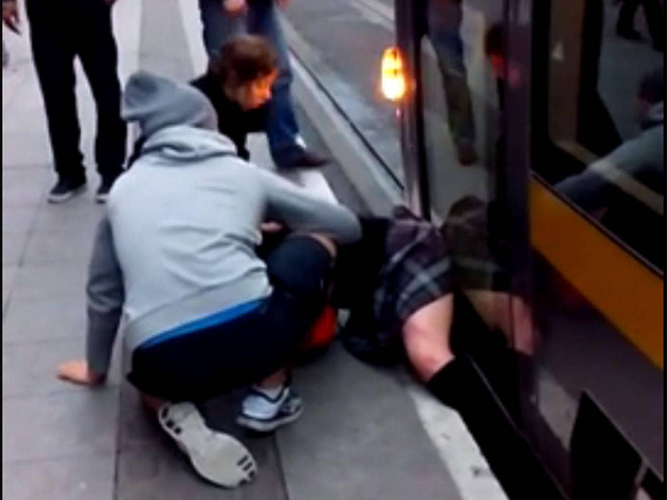 A still from footage showing a schoolgirl trapped under a tram in Dublin