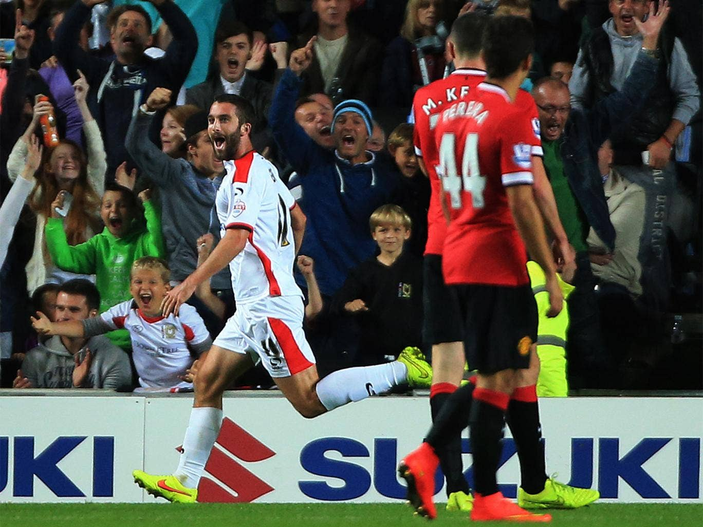 MK Dons' Will Grigg celebrates after scoring the second
