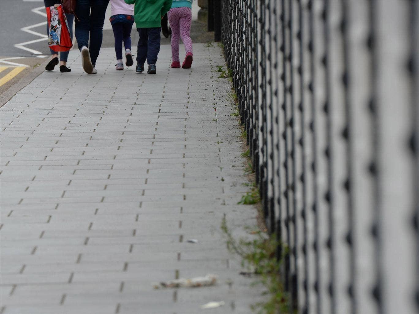 Children walk down a street in Rotherham, South Yorkshire