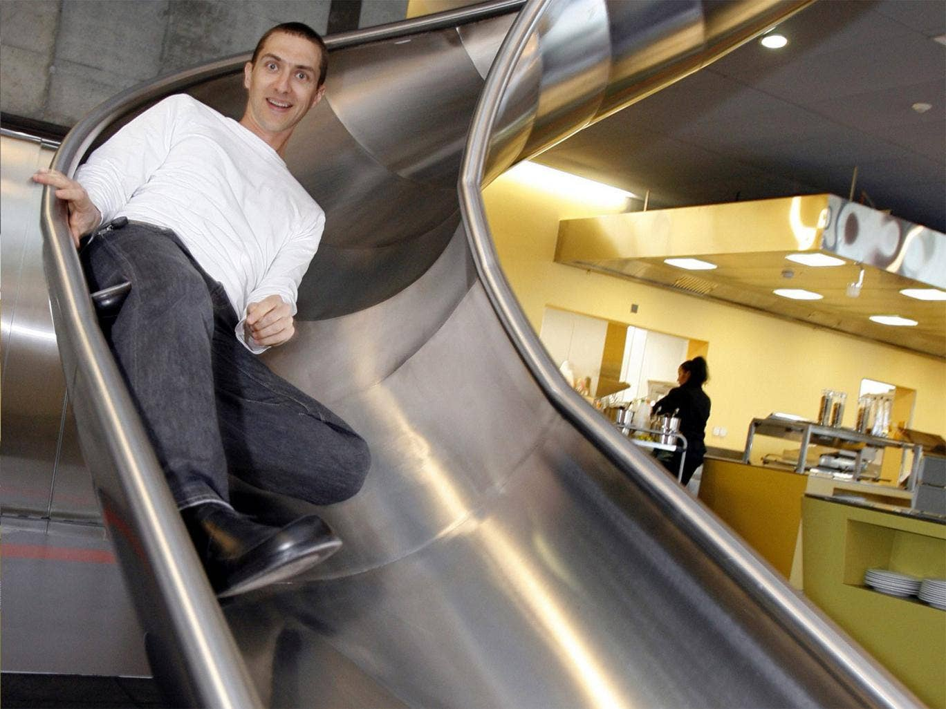 Down time: an employee of Google uses the slide to get to the canteen