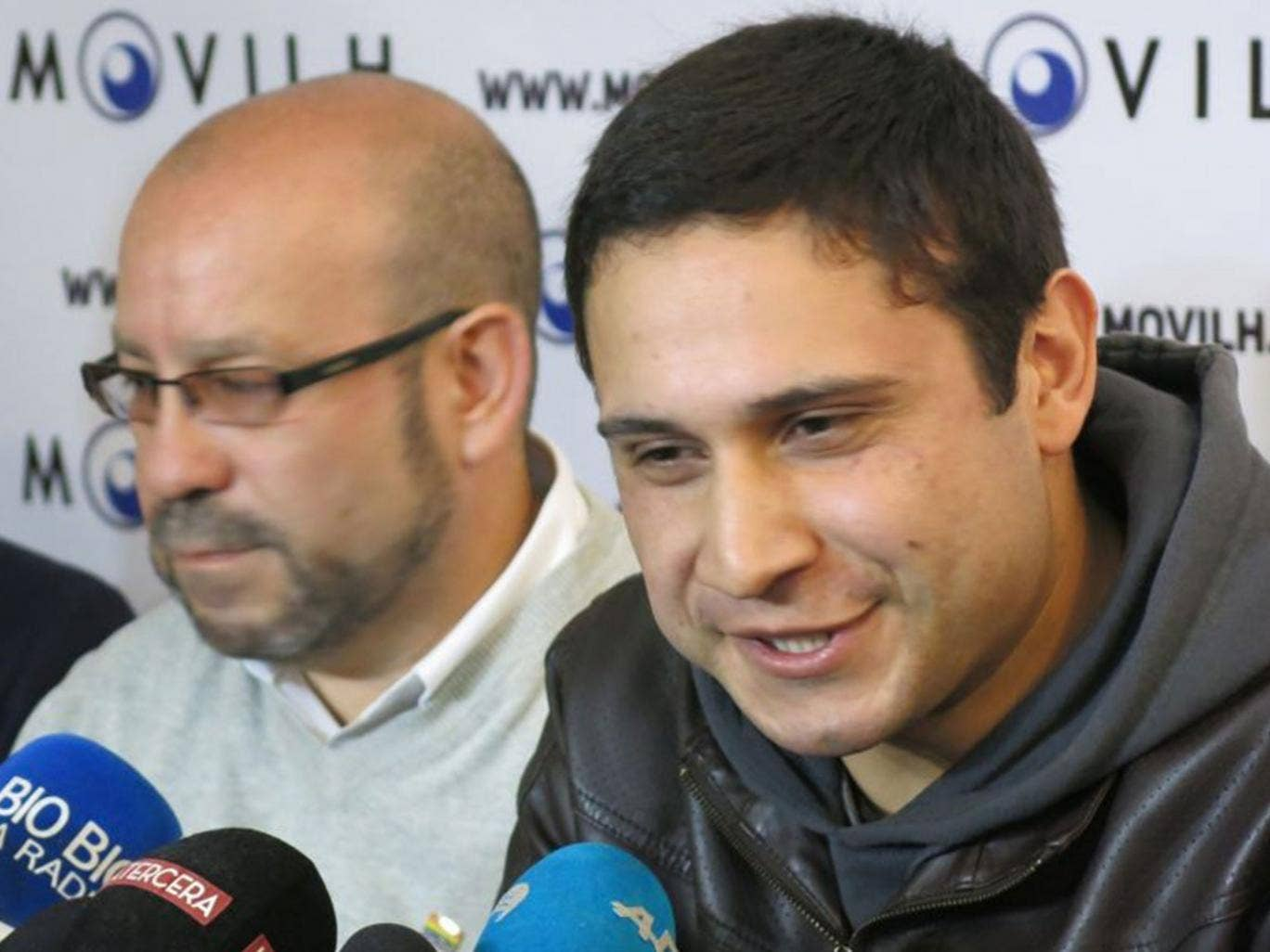 Chilean sailor Mauricio Ruiz, right, reveals he is gay during a press conference in Santiago
