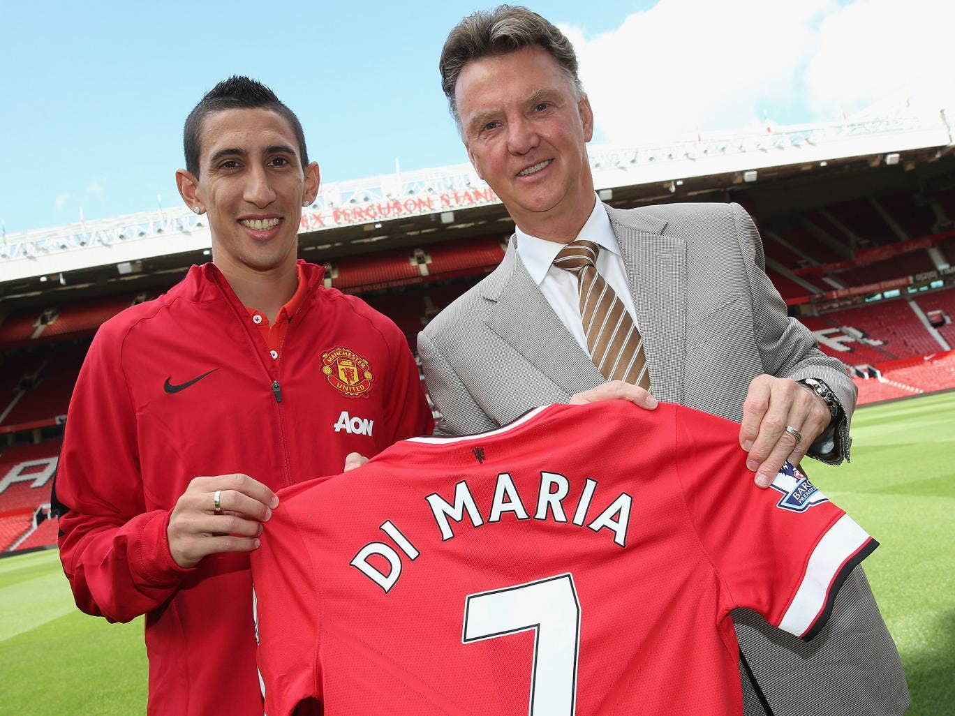 Angel Di Maria together with Louis van Gaal