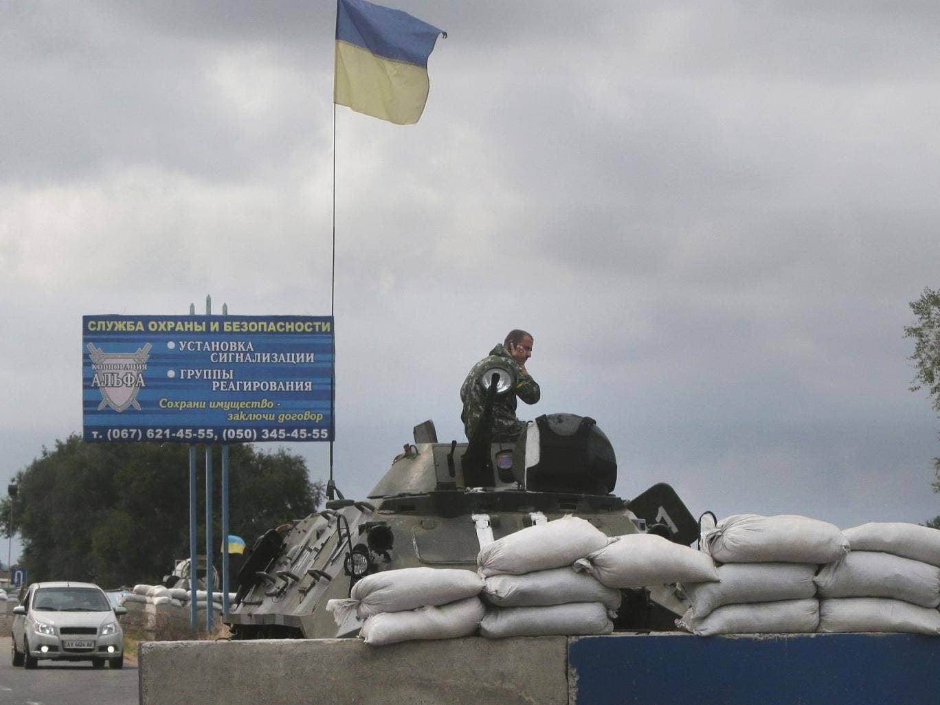 Ukrainian forces guard a checkpoint in the town of Mariupol, eastern Ukraine, which pro-Russian separatists claim is a major target in their rebellion against the government