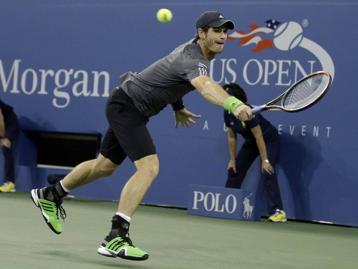 Andy Murray stretches for the ball during his straight sets second round win at Flushing Meadows