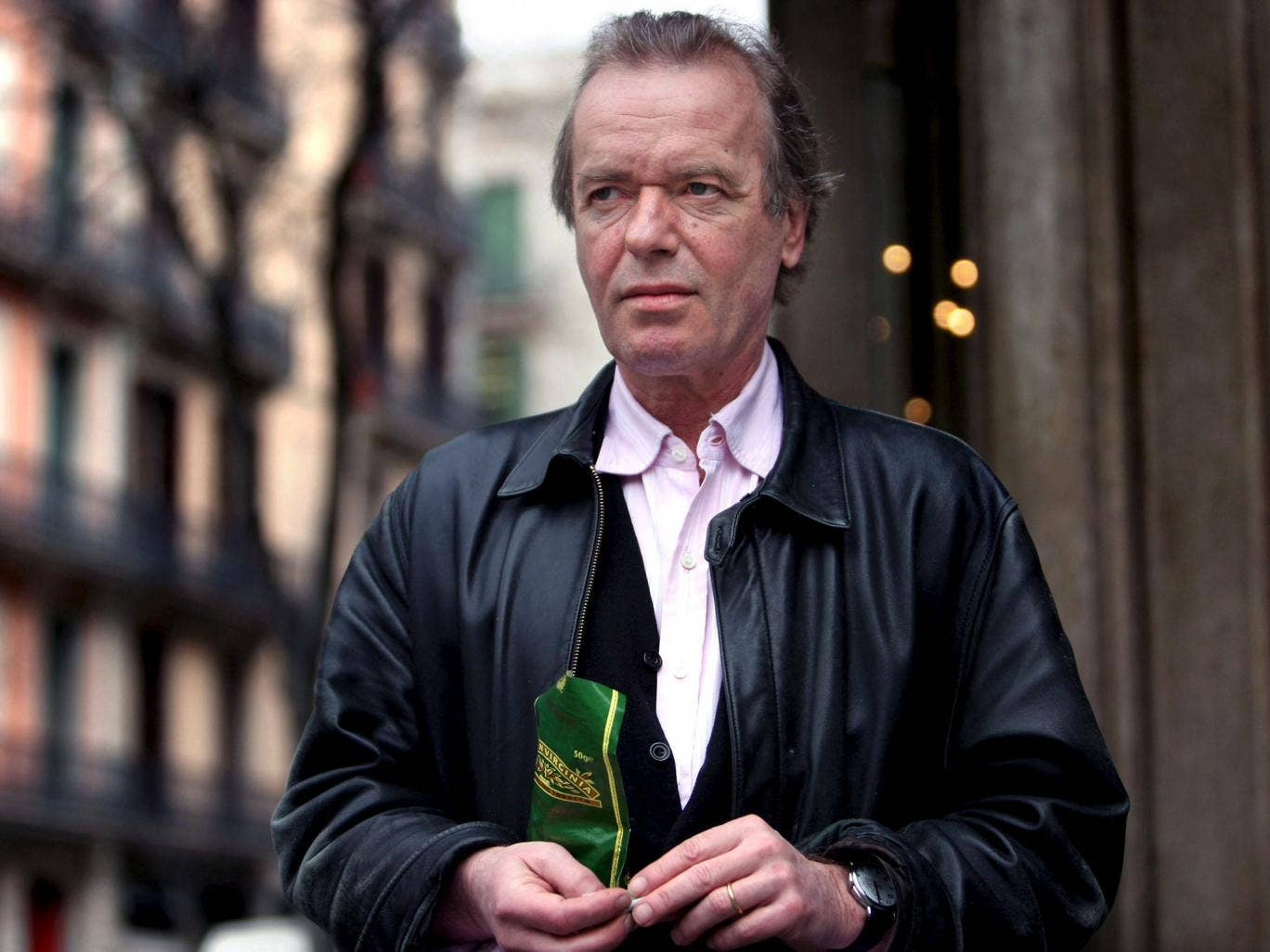Writer Martin Amis has indicated that he may return to Britain