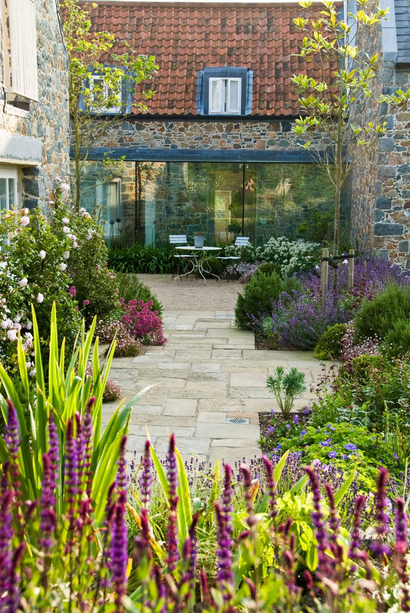 Debbie Roberts' courtyard garden in Guernsey makes the most of relaxed, lush planting