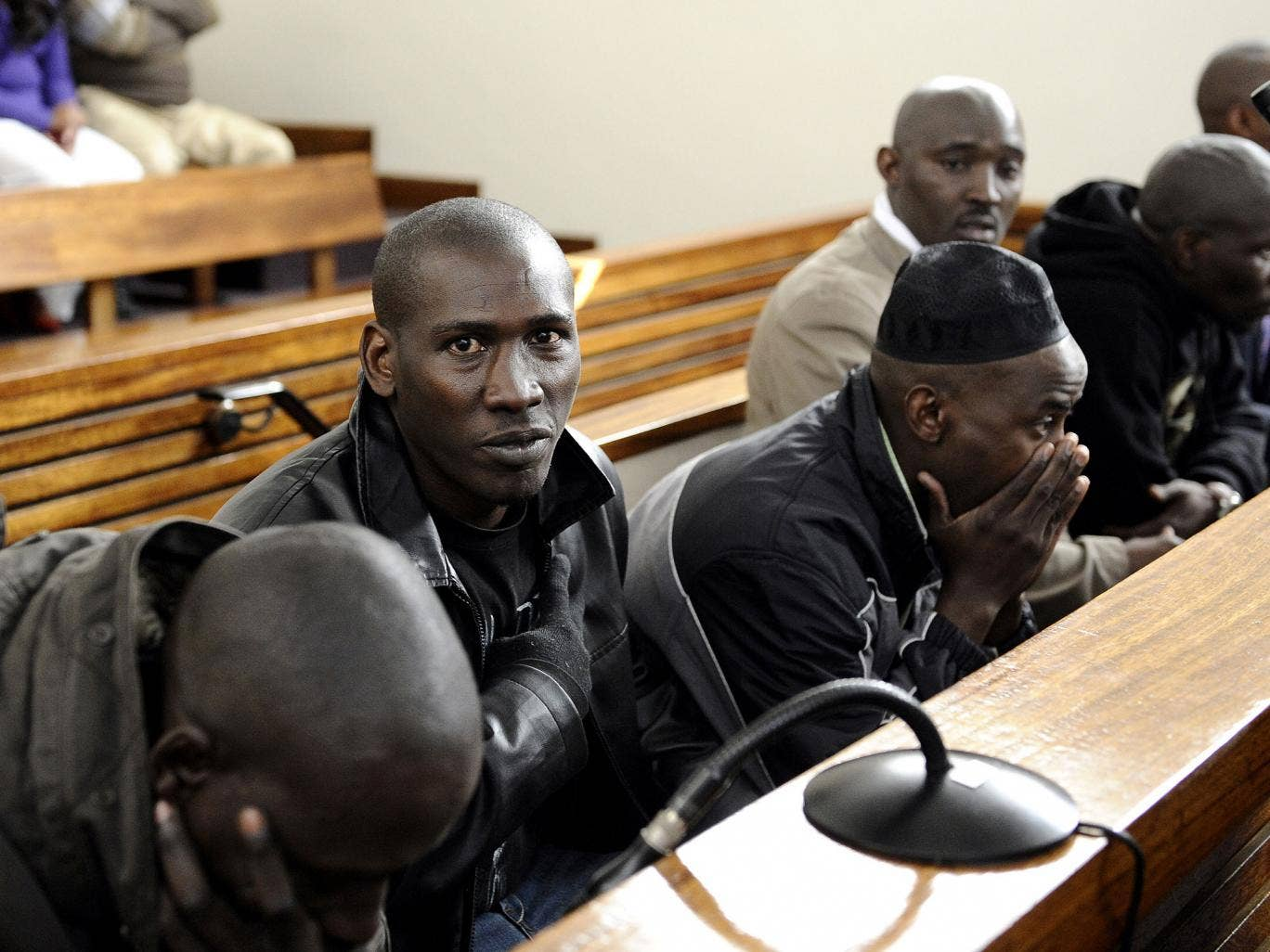 Six men charged with attempting to kill Rwanda's former army chief Faustin Kayumba Nyamwasa sit in court in Johannesburg. Four of them were convicted of attempted assassination yesterday