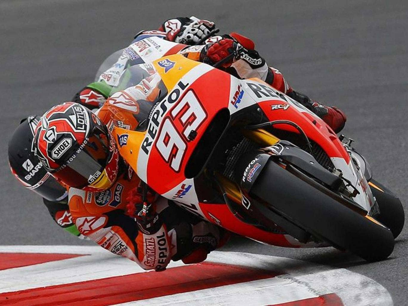 Lean time over: Marc Marquez leads Briton Scott Redding in qualifying at Silverstone after coming fourth last time