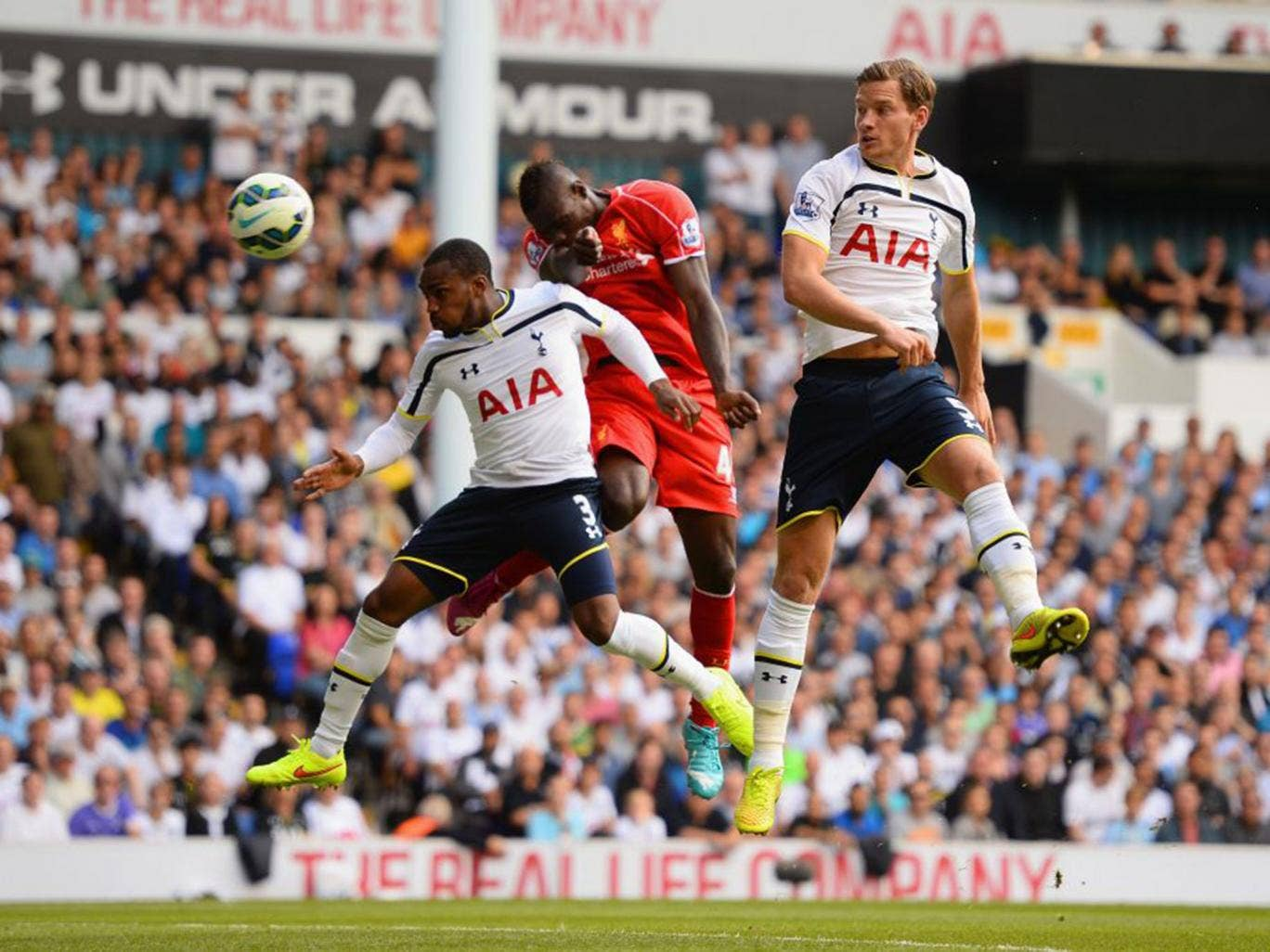 Mario Balotelli has an early header on goal during his Liverpool debut against Tottenham