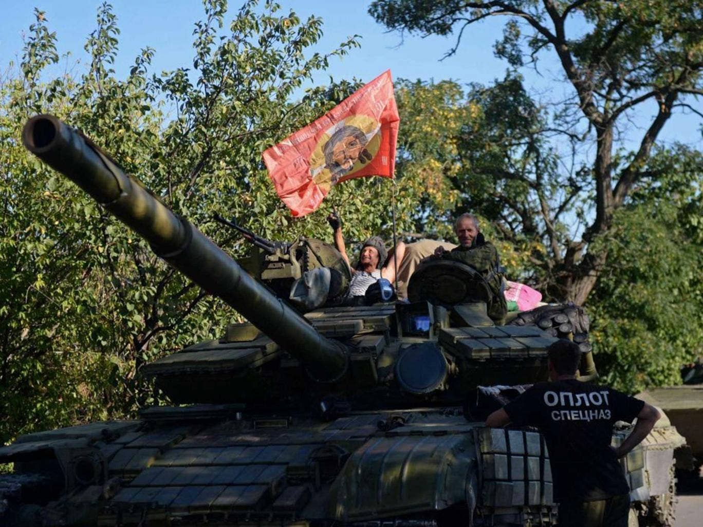 A Russian fighter atop a tank, photographed yesterday southeast of Donetsk