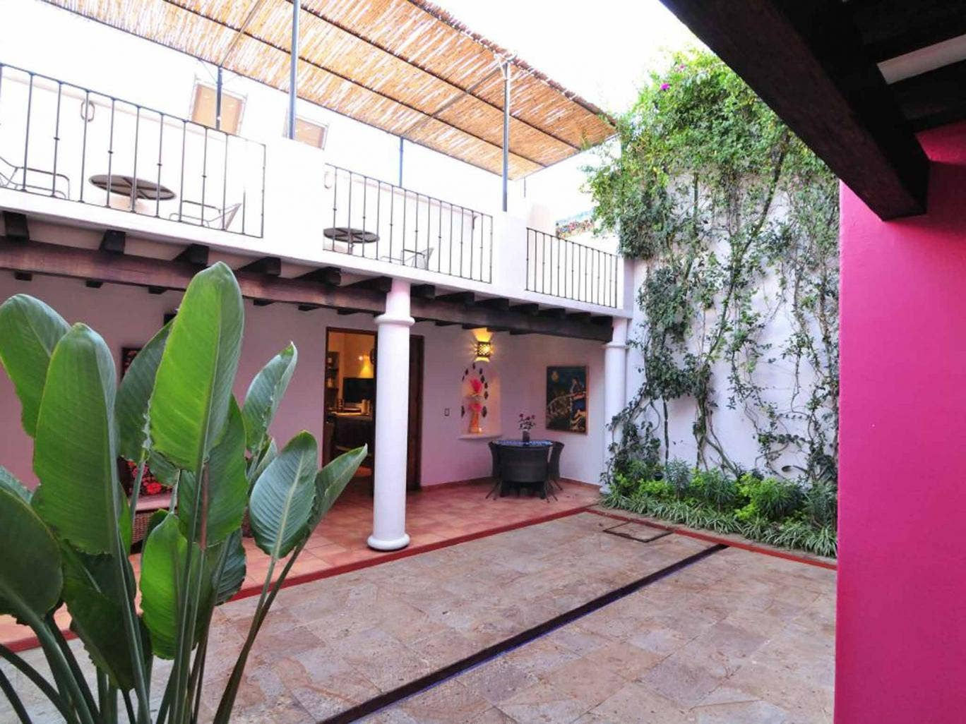 Tropical tastes: Bright colours and cool corners define the casa's central courtyard and kitchen