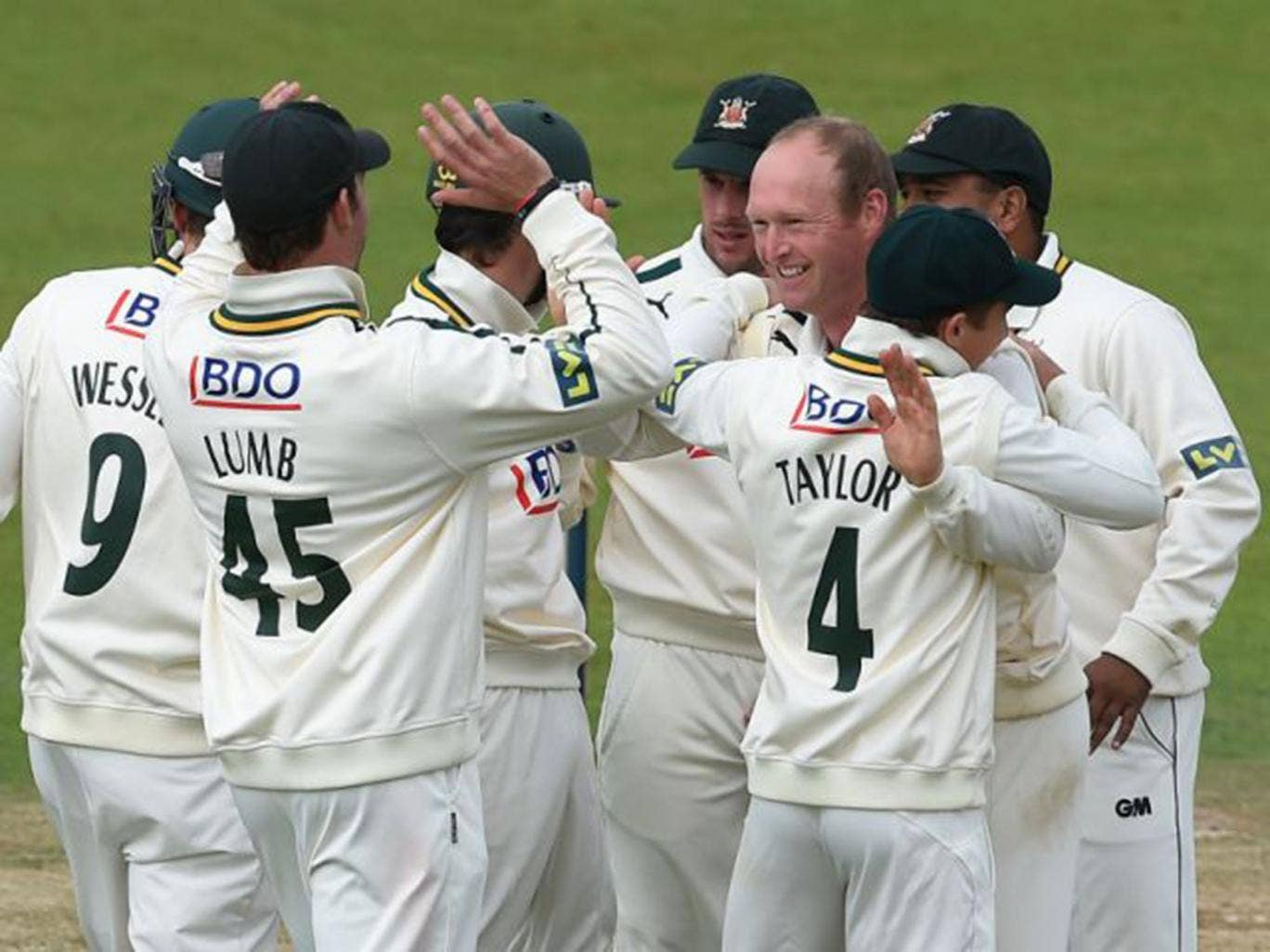 Gary Keedy (third right) celebrates having Mark Stoneman caught behind for his first wicket