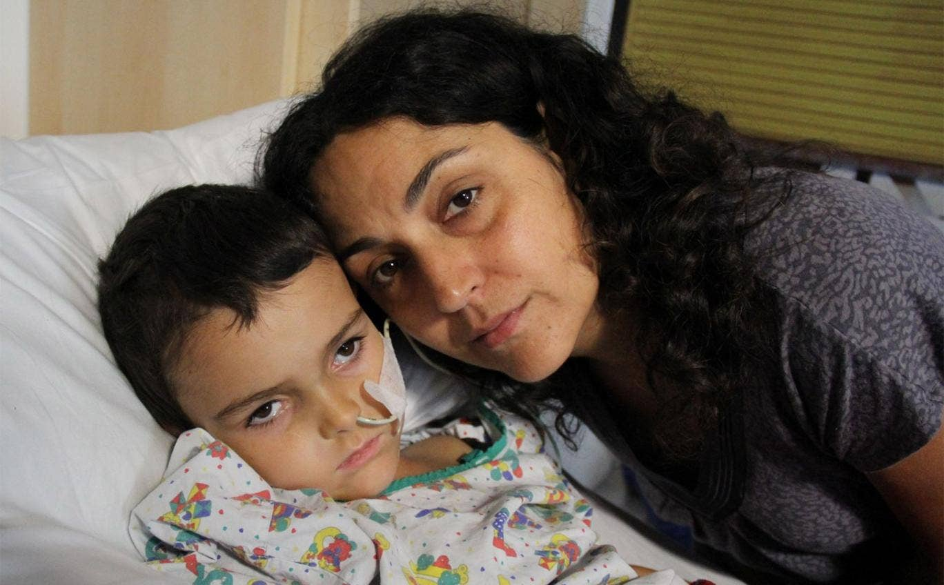 Ashya King in hospital with his mother