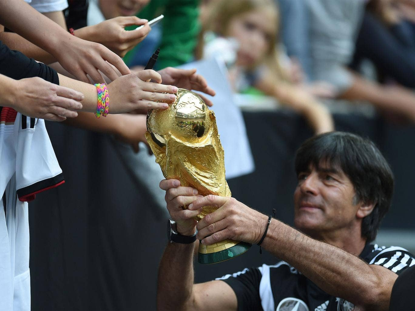 45,000 fans turned out for open training and a glimpse of the World Cup trophy, held by Germany coach Joachim Löw, ahead of his side's sell-out friendly match against Argentina – a repeat of the final in Brazil this summer