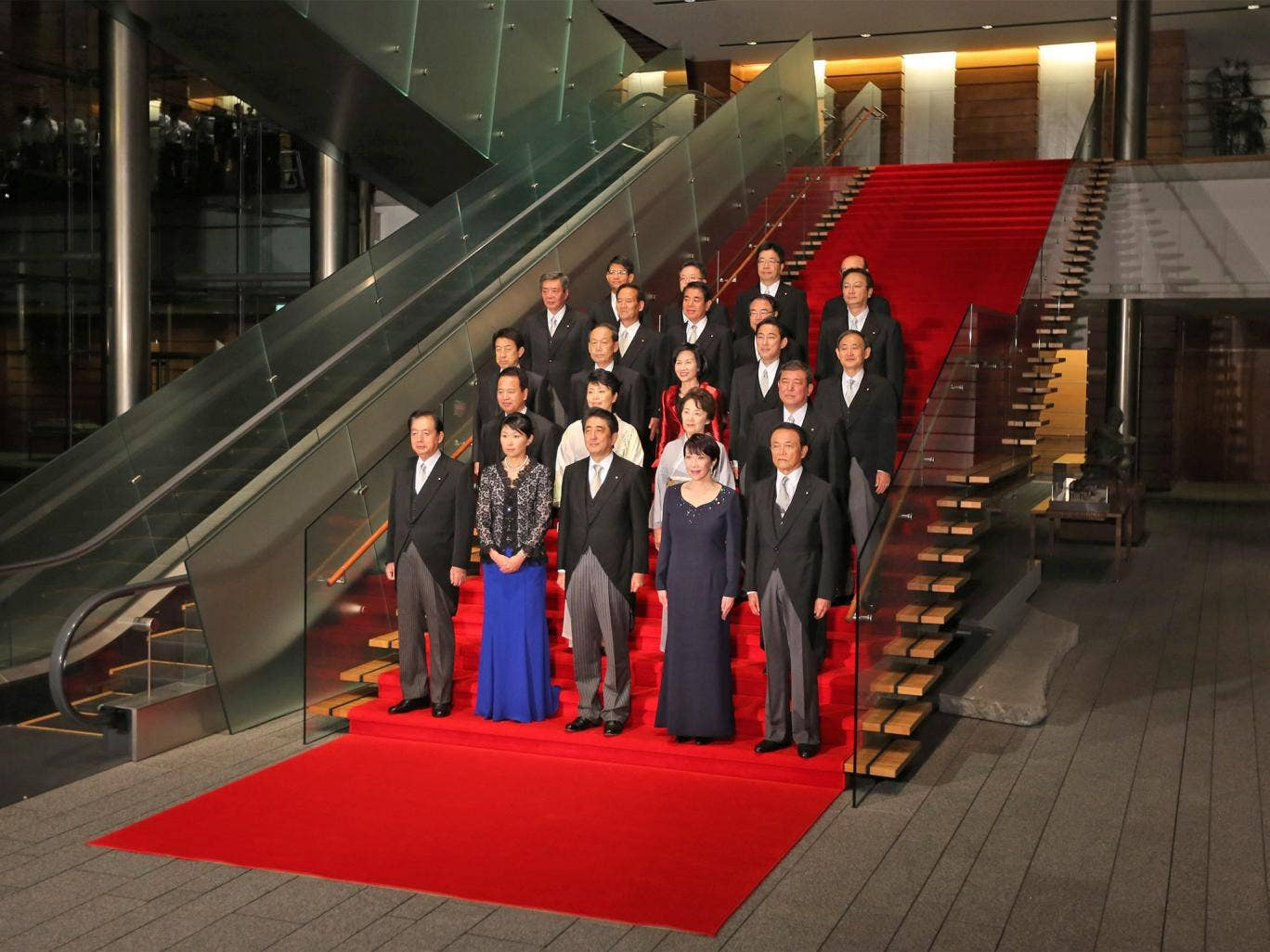 Prime Minister Shinzo Abe (centre, front) poses with members of his new cabinet, which includes five women, following their first meeting at his official residence in Tokyo