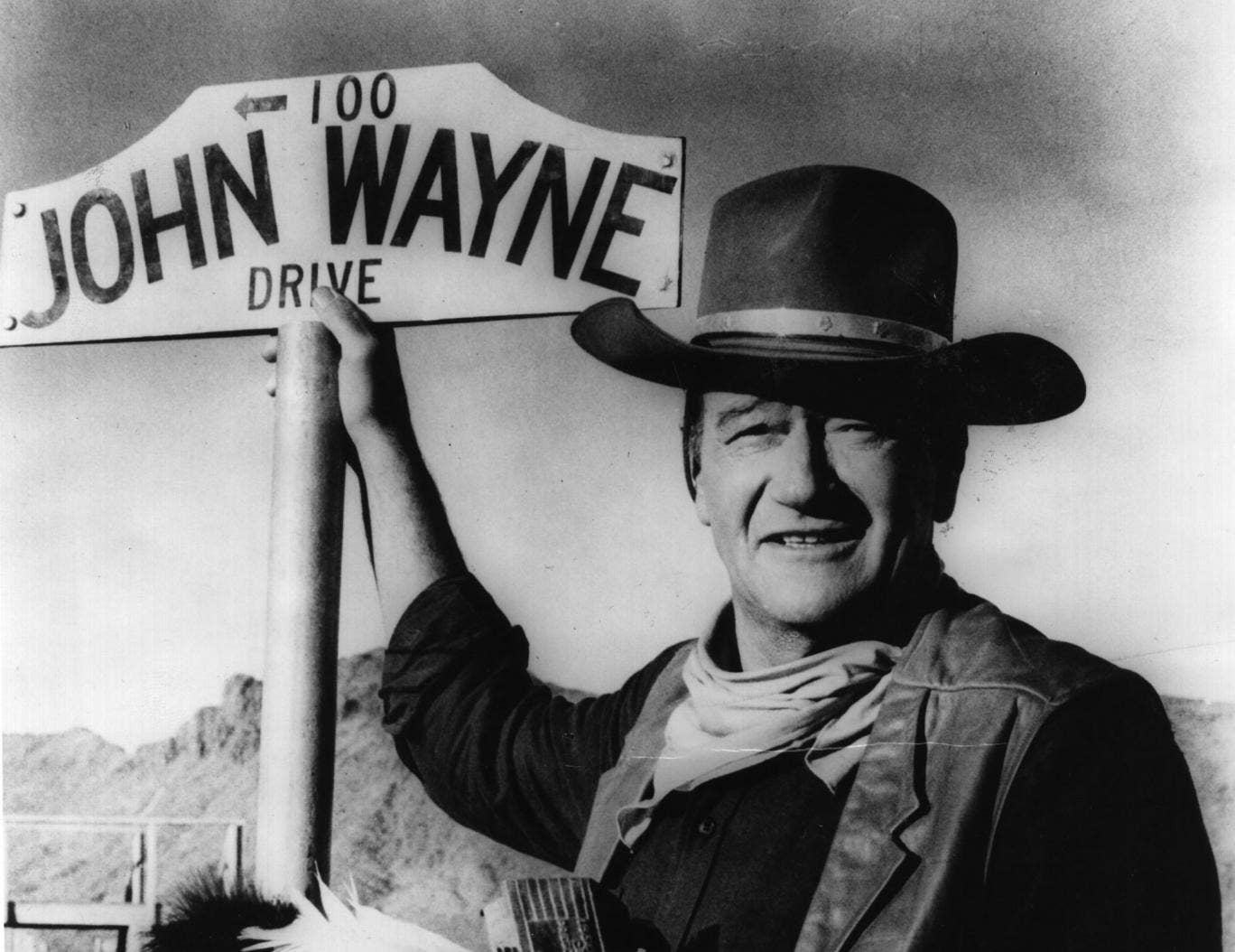 The late actor John Wayne, who starred in several Andrew V McLaglen films, with his sign in 1966