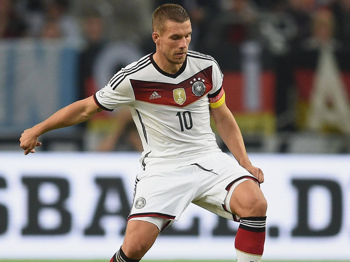 Lukas Podolski in action for Germany against Argentina last night