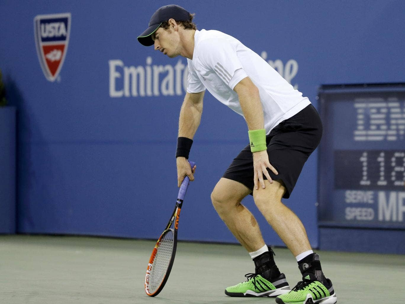 Andy Murray shows the strain during his US Open quarter-final defeat to Novak Djokovic