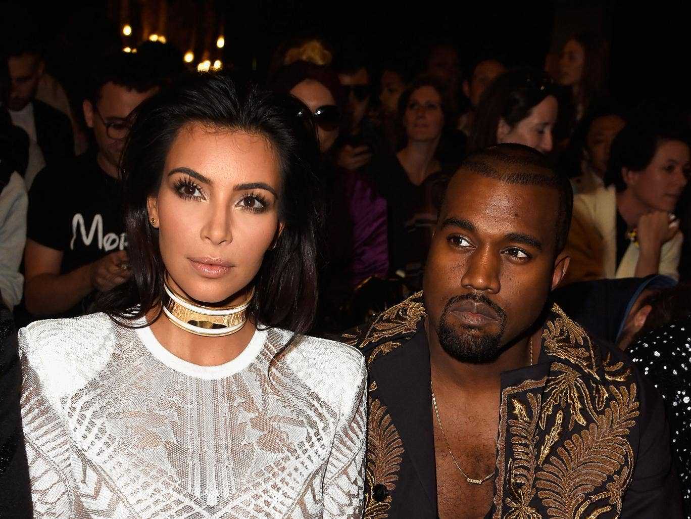 Kim Kardashian West and Kanye West on the front row of the Balmain fashion show in Paris, September 2014