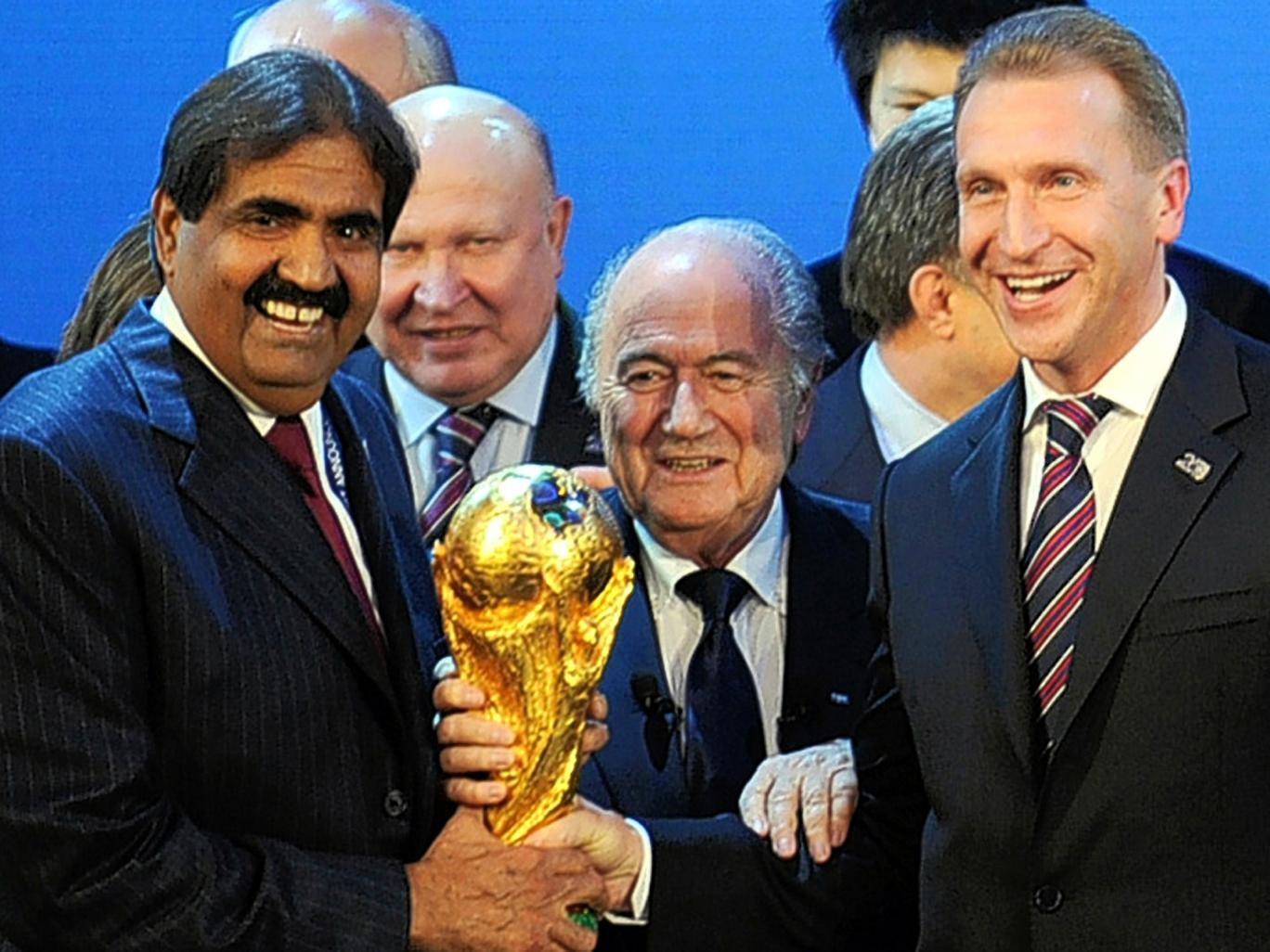 The Emir of Qatar Sheikh Hamad and Russia's deputy prime minister Igor Shuvalov flank Fifa president Sepp Blatter