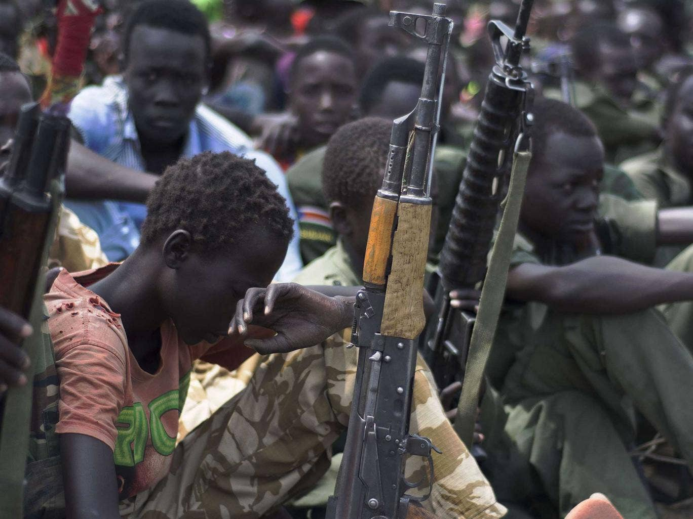abducted children forced to become soldiers Child soldiers have become productive, capable and  dren become more easily  armed, and as con-  abducted and forced to take on di¡erent roles.