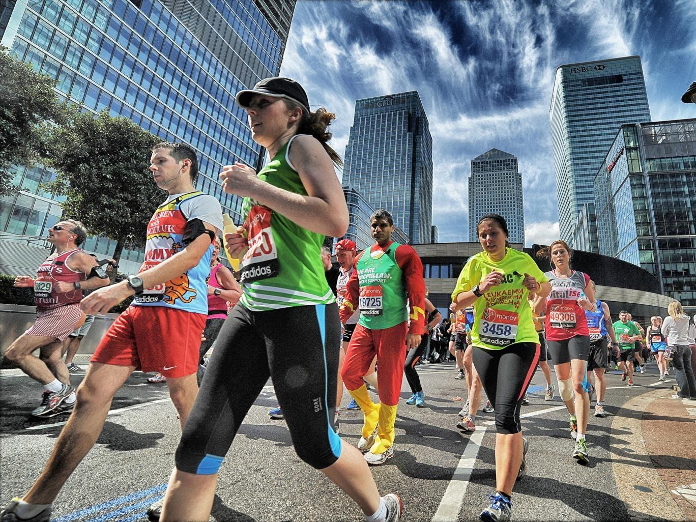 Runners reach the nineteen mile mark of the London Marathon