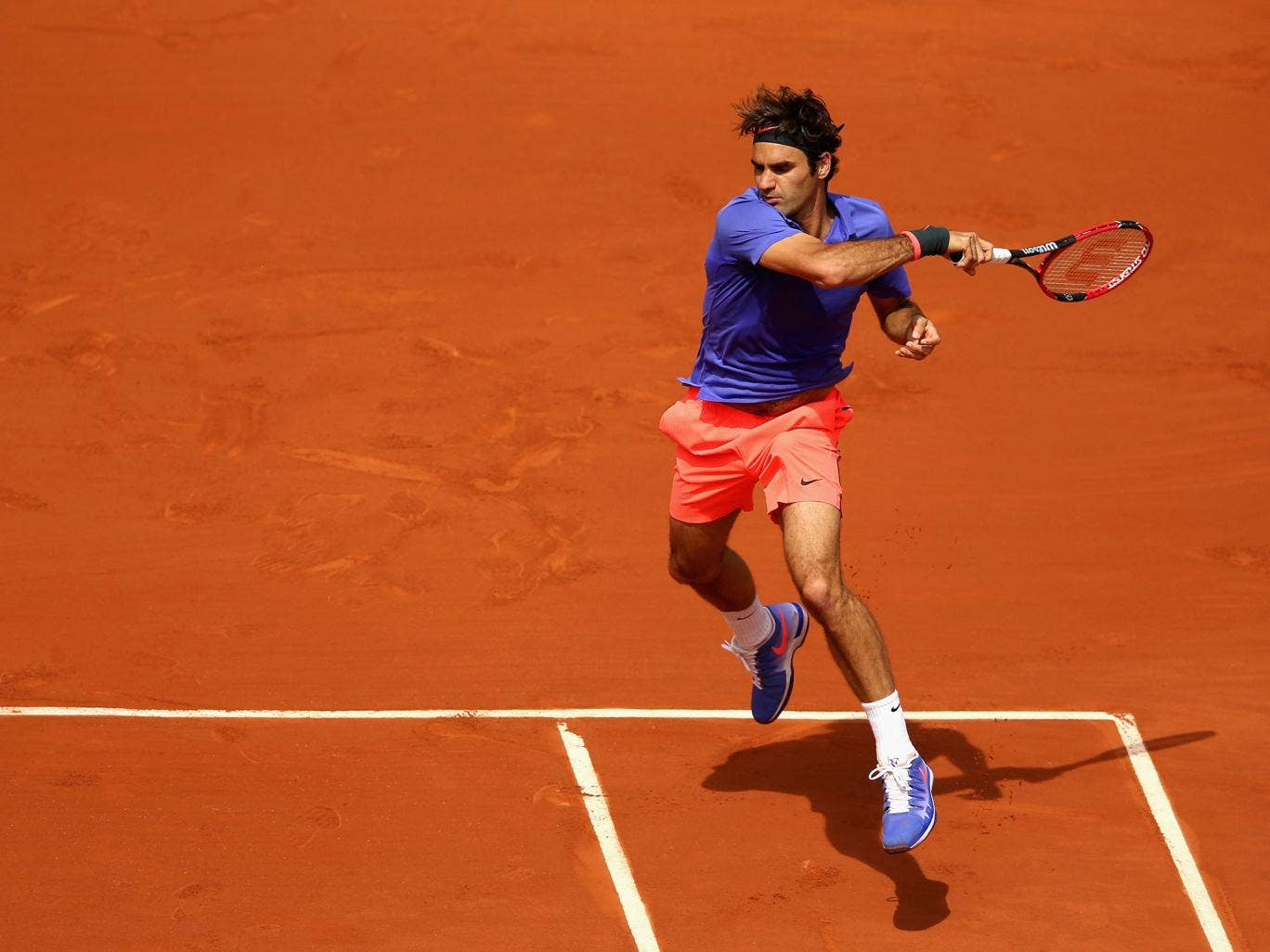 roger federer in action at the french open. Black Bedroom Furniture Sets. Home Design Ideas