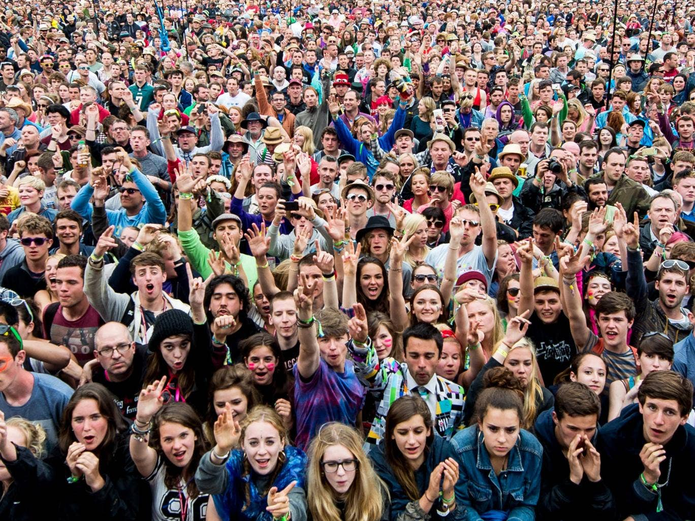 Glastonbury 2015: The picture of a man crowd surfing in a ...