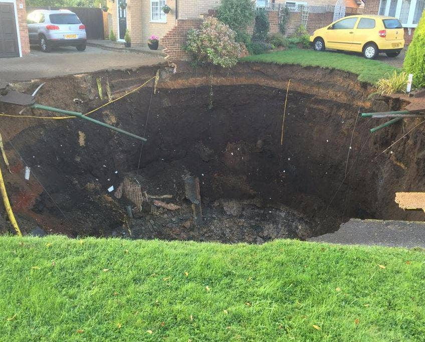sinkhole appeared on a residential street overnight