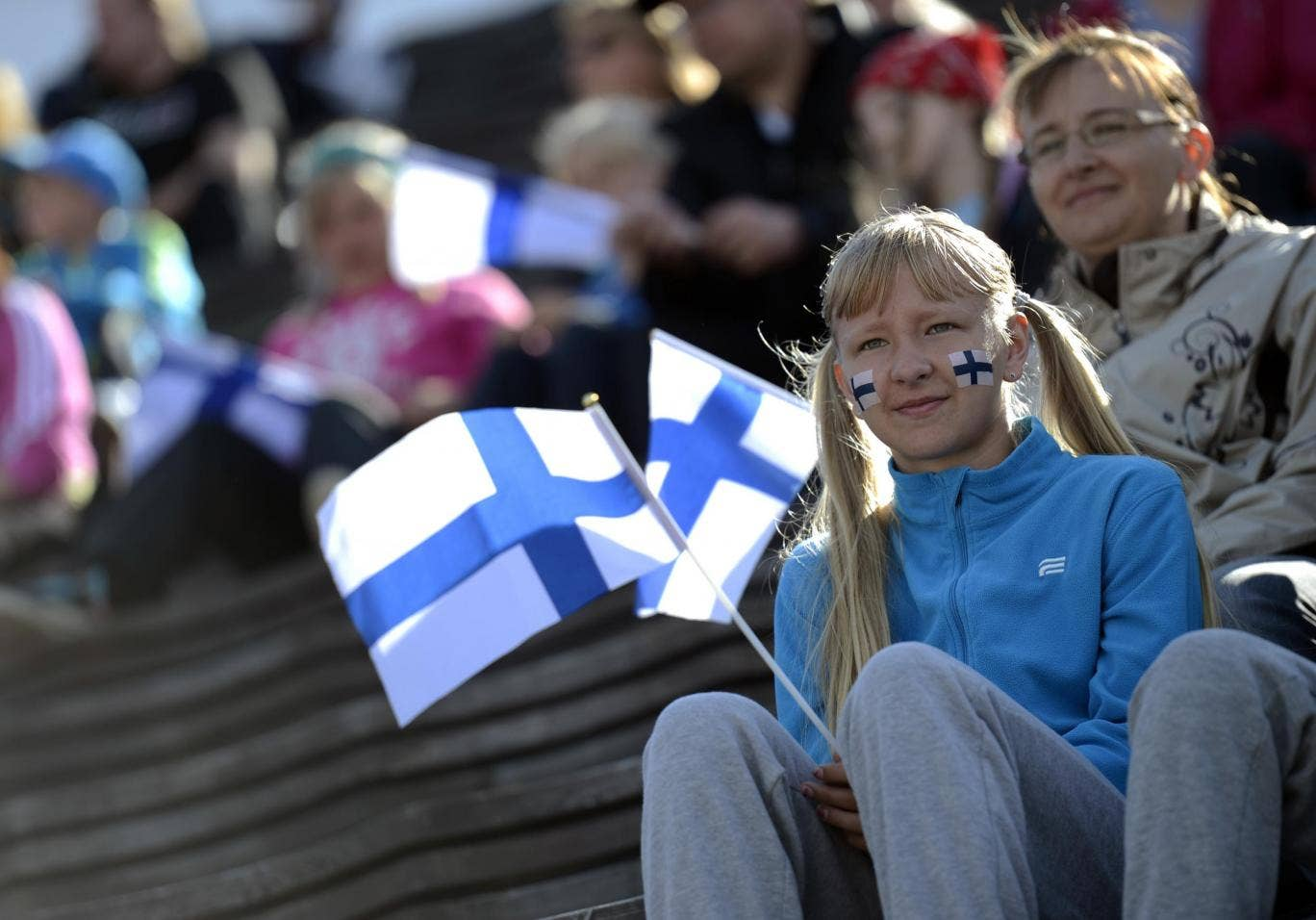 Girl holds a Finnish flag at the 2012 European Athletics Championships