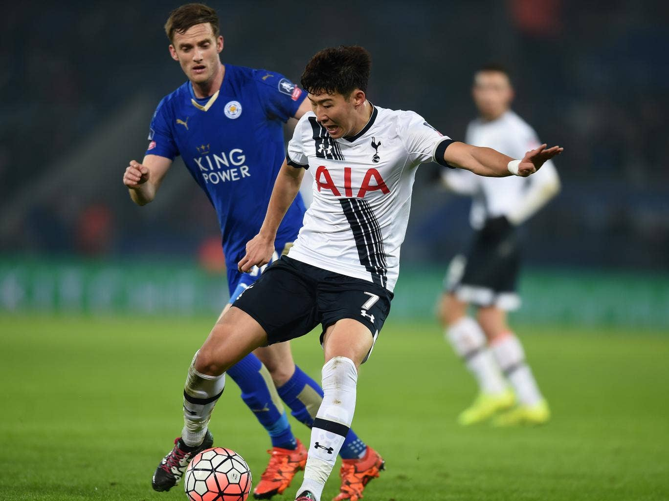 Son Heung-min competes with Andy King during the FA Cup third round replay